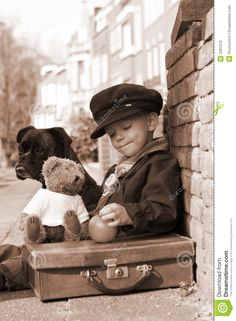 Vintage photo of a little boy and his dog