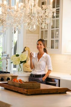 Cabinet paint color: Benjamin Moore paint but Kelly Moore's formula for Swiss Coffee Kitchen wall color: Benjamin Moore in Ballet White.