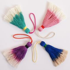 Bold tassels in cobalt, pink, purple, and teal
