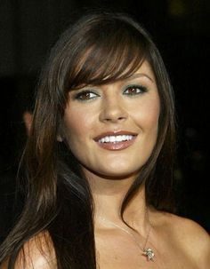 Catherine Zeta Jones. So beautiful. And I've been thinking about getting bangs like these...