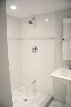 Bathroom - subway tile with small, subtle mosaic inlay.