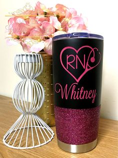RN with Name Choose your Glitter & design color! ____________________________________________________________________ ♥ 20 oz Black tumbler ♥ Push on lid ♥ Vacuum Insulated ♥ 5+ hours for warm drinks // 12+ hours for cold ♥ Please do not microwave ♥ Hand wash ♥ Hand Engraved - 100% permanent OR ♥ Made with outdoor grade permanent vinyl. 6+ years with proper care. ♥ Please do not pick or scratch at the design. ♥ Glitter is sealed (twice!) so it will not flake! ♥ Stainless Steel ...