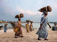 """""""Women of Fadiouth"""". Anna Ndiaye (President of the Gie Mbel Saac Federation on Fadiouth Island in Senegal) fights to defend the quality of salted millet couscous. (Photo by Steve McCurry/2015 Lavazza Calendar)"""