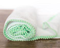 DIY Pom Pom Swaddle Blanket Tutorial - Simple Simon and Company