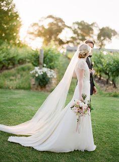 Romantic Wedding Dress with a Long Veil   Jemma Keech Photography