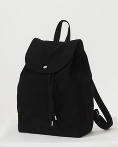 A simple canvas satchel for daily essentials. Drawstring and flap closure w. Black Backpack, Backpack Bags, Canvas Backpack, Leather Backpack, Drawstring Backpack, Stylish Backpacks, Girl Backpacks, Cute Backpacks For Women, Stylish School Bags