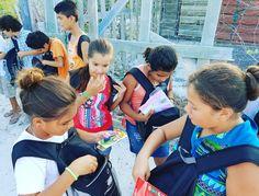 Excited Club A kids, looking in their new backpacks to find school supplies, uniforms, and shoes! Niños emocionados de Club A al ver los contenidos de sus nuevas mochilas: ¡útiles, uniformes, y zapatos! #cluba #afterschoolprogram #helpneedykids #bethechange #volunteerincostarica #servoluntarioencostarica #programaextracurricular #programforlove #futurosbrillantes #educacionespoder