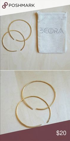 """Beora Jewelry Brass Hoop Earrings Organic shape, round hoop earrings. Hand made with hammered and polished brass, with ear insert opening. Approximately 2"""". With bag. Beora Jewelry Jewelry Earrings"""