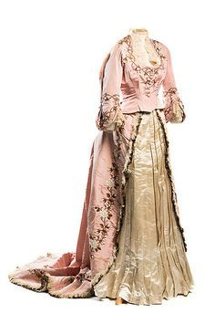Dress, 1870s, Mme Gabrielle Rose silk faille dress, 1870s. Labeled Mme Gabrielle / Robes & Confections / 205 Rue St. Honoré, this elegant creation was designed by one of the premier couturiers of the 1860s and 1870s. The floral embroidery ornaments the bodice and the skirt, with its bustle and train. It was worn by Gertrude Ellen Dupuy who married Henry Shelton Sanford in 1864, both of wealthy American families. Charleston Museum, South Carolina.