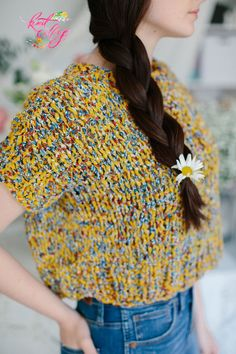 Looking for the perfect summer knitting project? The High Vibes Tee has you covered! This light and airy knit tee is made with just 5 skeins of our 100% cotton chunky Wildflower yarn (color Goldenrod shown here). Click through to check out pattern details and all of our new spring yarns! #knittop #knittee, #summerknitting #springknitting, #bohoknittop #chunkyyarn #yarn #knitting #diytop #diy