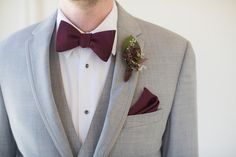 Groom in light gray tuxedo with burgundy bow tie and matching pocket square {Joleen Willis Photography}