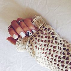 Top 10 Simple Ways to Spice Up White Nails--This gorgeous look is achieved with three colors: white, black and grey. The basis is white, and the gray and black are applied the same way you will apply normal french. Between the colors are little silver patches that are completing the look perfectly.