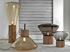 Dan Yeffet and Lucie Koldova have created a series of hand blown ambient lights with oak wood bases for lighting brand Brokis.