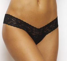 Lowrise Thong in Black by Hanky Panky at Pesca Trend. Hanky Panky's signature lace thong sits lower on the hips. The world's most comfortable thong features a flattering V waistband. Offers no visible panty line. Thong provides minimal coverage in the back. Available in black. Body made from 100% nylon, trim from 90% nylon and 10% spandex, and lining made from 100% cotton in the USA by Hanky Panky.