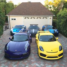 Porsche Carrera GT painted in GT Silver wrapped in Blue Chrome, 997 GT3 RS painted in Black, 918 Spider painted in Black and wrapped in Blue Chrome, GT3 RS painted in Ultraviolet Purple and a Cayman GT4 painted in Racing Yellow  Photo taken by: @salomondrin on Instagram (He is also the owner of the cars)