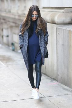 Maternity style in cool outfit and a cover up coat.