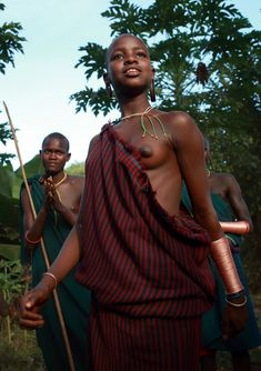 Ethiopia, tribes, Surma, Suri people Suri girl and boy at a traditional dance in Anjo village, Kibish.