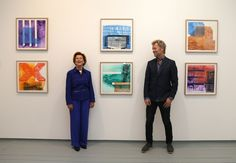 Norway's Queen Sonja (L) and Magne Furuholmen of Norwegian band A-ha pose in front of paintings at the opening of their joint exhibition in London on September 27, 2016..The show entitled Texture, is a portfolio of ten prints by Norway's Queen Sonja and Magne Furuholmen, made in support of The Queen Sonja Print Award (QSPA).  / AFP / DANIEL LEAL-OLIVAS / RESTRICTED TO EDITORIAL USE - MANDATORY MENTION OF THE ARTIST UPON PUBLICATION - TO ILLUSTRATE THE EVENT AS SPECIFIED IN THE CAPTION