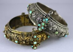 Two bracelets silver bracelets with turquoise, one gilt, made by the same silversmith or workshop. These are called shumaylat bracelets and were made by Yemenite Jews in Sanaa and worn by Jewish brides in pairs. With filigree and granulation.