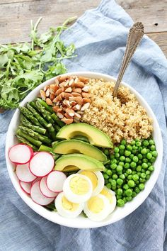 Spring Quinoa Bowl Recipe on http://twopeasandtheirpod.com This simple and healthy quinoa salad bowl is the perfect spring meal!