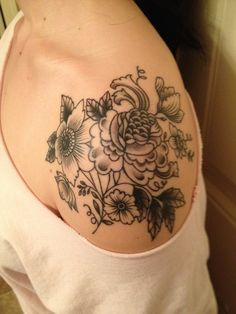 Shoulder tattoo. Love the placement, swap the flowers out for the style of roses on my side and the scroll leafing.