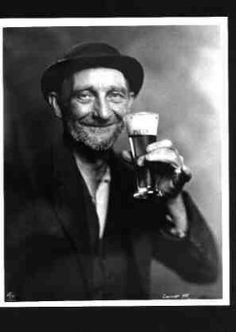 Photo of an Old Man Drinking a BEER c1937