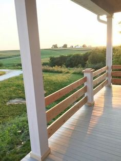 Make a rolling gate for your porch diy do it yourself pinterest horizontal slat porch railing like the half post detail solutioingenieria Gallery
