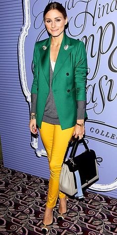 Great layering: green jacket, grey sweater & yellow pants