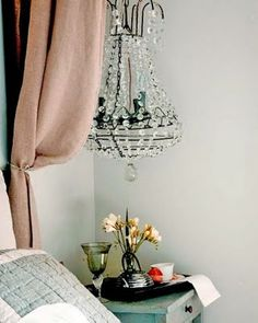 chandelier at the bedside... charming