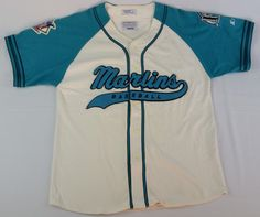 ITEM: Florida Marlins vintage MLB jersey BRAND: Starter STYLE: Script Baseball Jersey MATERIAL: Embroidered SIZE: Men's Large DIMENSIONS (INCHES) Pit to Pit: 22.5 Top to Bottom: 30 CONDITION: Pre-Owne