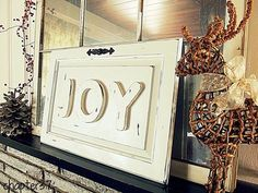 """Wooden sign with the word """"joy"""" in raised wooden letters. This decorative sign could be used for Christmas decor, or all year long. Hang it on the ..."""