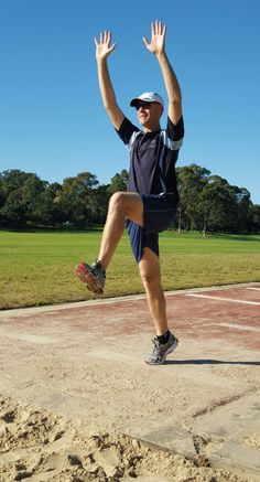 An image demonstrating a long jump take-off position with arms extended above the head. Triple Jump, Long Jumpers, Track And Field, Coaching, Running, Workout, Athletes, Arms, Activities