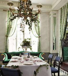 The curtains in designer Jean-Paul Beaujard's dining room in his Manhattan duplex are made from a vintage fabric by Madeleine Castaing (September 2011). Photo: Miguel Flores-Vianna