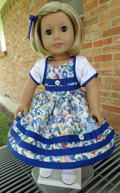 18 Doll Clothes 1950's Fashion Summer Dress by Designed4Dolls. A very pretty blue, white, red and yellow print cotton dress with royal blue trim. White cotton shrug also trimmed in royal blue. A great party set for Maryellen! By Designed4Dolls.