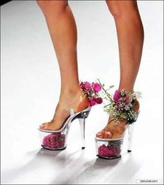 I actually have a pair like this I won in a contest, sans flowers. I'm thinking I need to add the flowers to wear them!