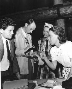 Planning The Hollywood Canteen Are John Garfield, Unknown, Bette Davis And Jean Lewin