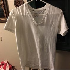 Distressed White V-neck Perfectly distressed and can be worn with high wait denim and ankle boots. Fits a small best. Tops Tees - Short Sleeve