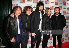 Ian Matthews, Sergio Pizzorno, Chris Edwards and Tom Meighan of Kasabian arrive at the NME Awards at Brixton Academy on February 18, 2015 in London, England.