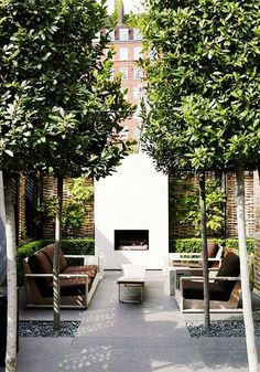 the ultimate outdoor living room in a London city garden, outdoor fireplace, table & seating surrounded by green, stone, & gravel Outdoor Rooms, Outdoor Gardens, Outdoor Living, Outdoor Sitting Areas, Zen Gardens, Courtyard Gardens, Modern Gardens, Outdoor Patios, Cottage Gardens