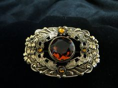 Hey, I found this really awesome Etsy listing at https://www.etsy.com/listing/178173606/art-nouveau-czech-brooch-with-topaz