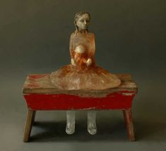 Christina Bothwell , Good Faith - cast glass, raku clay, and found object 16 x 15 x 5.9 inches (So nice with the red desk )