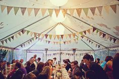 Way to use homemade garlands to dress up a rented tent