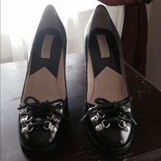 """Host Pick 5/8/16🎉Michael Kors Black Leather Shoes Black Leather Pumps (not patent leather) with a bit of """"Edge""""! Shoe features Six, Silver Tab & Loop Grommets with Black Shoe Cord to tie in a Bow at front. Footbed Sole rubberized with Treads for traction. Leather sole & 3.5"""" stacked, black wood Heel. Made in Italy. So cute with Leggings, Jeans or a Short Pleated Skirt! No marks/scuffs; (small """"ding"""" on right heel, but not noticeable). Excellent condition. Worn a couple times. Price…"""