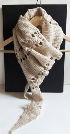 Knit and crochet combination scarf. Bands of open lace crochet in between garter stitch.