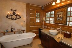 Clawfoot tub, and the upraised bowl sinks! Perfect rustic bathroom!