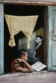 Steve McCurry, Monk reads Buddhist scripture at monastery, Yangon Rangoon, Burma, 1995.