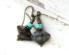 Everyday earrings made with rustic green patina greek beads and turquoise chips. Boho Jewelry Collection.    Total length is 37mm (1.5). Antique
