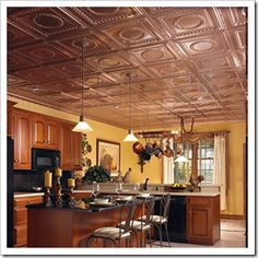 Hopefully, copper tiles are in the not-too-distant future above the bar in my kitchen.  (and probably on the wall space underneath the bar, too).