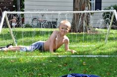 Cool idea.  Sprinkler tent made of PVC pipe...