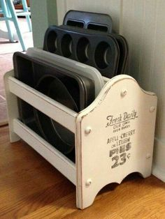 Old magazine rack used to store baking sheets and muffin tins